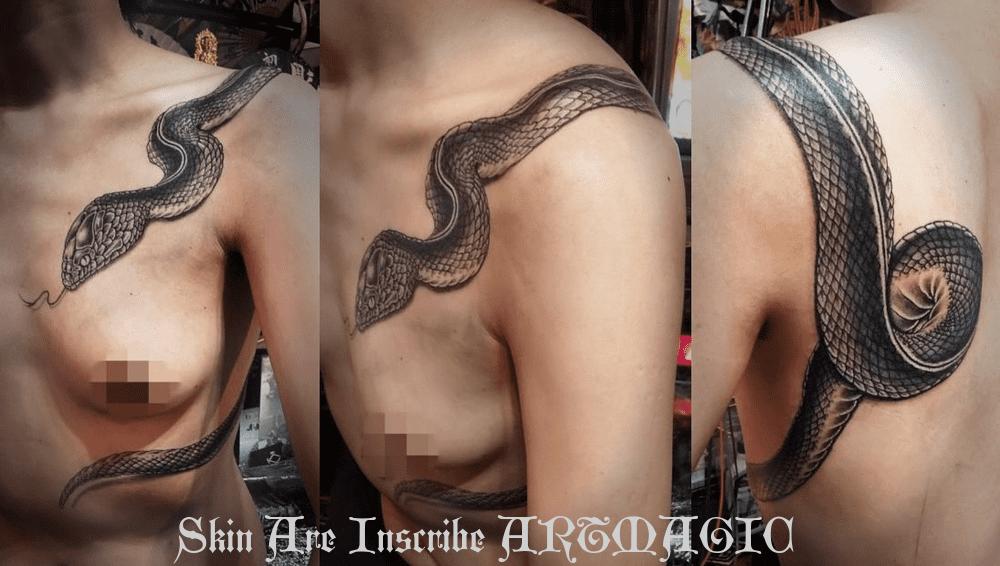 蛇・女性・タトゥー・刺青